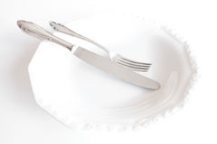 Empty plate with knife and fork , beautiful cutlery Stock Photography
