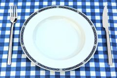 Empty Plate, Knife And Fork On The Chrckered  Picnic Tablecloth Royalty Free Stock Photos