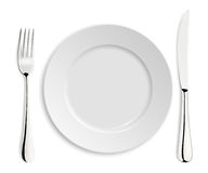 Empty plate with knife and fork Stock Photos