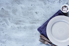 Empty plate, knife and fork Stock Image
