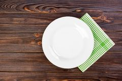 Empty plate with napkin on grey wooden table Stock Images
