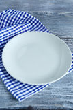 Empty plate on a napkin. Top view Royalty Free Stock Photos