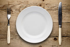 Empty plate, old fork and knife Stock Photography