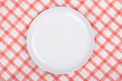 Empty plate over checkered background Stock Photography