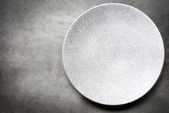 Empty Plate over Slate Top View Royalty Free Stock Images