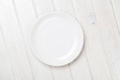 Empty plate over white wooden table Stock Image