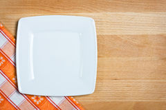 Empty plate over wooden background Stock Image