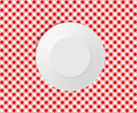 Empty plate on a red checked tablecloth. Ideal for placing in the background of your design. Vector file included Royalty Free Stock Image
