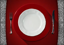 Empty Plate on Red Velvet Background Royalty Free Stock Images