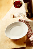 Empty plate with red wine and a napkin Royalty Free Stock Image