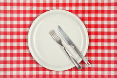 Empty plate on restaurant table Royalty Free Stock Image