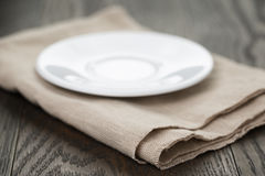 Empty plate on rustic table Stock Images