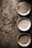 Empty plate and saucer. At abstract  background Royalty Free Stock Images