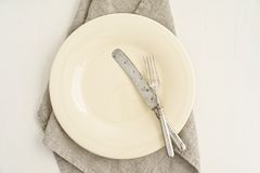 Empty plate with silverware Stock Photo