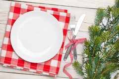 Empty plate, silverware and christmas tree Royalty Free Stock Photography