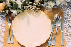 Empty plate with silverware on table, void Stock Images