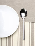 Empty plate with spoon Stock Images