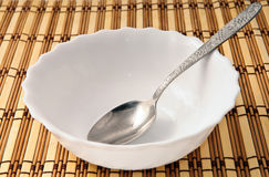 Empty plate with spoon Stock Photos