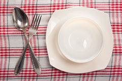 Empty plate, spoon and fork Royalty Free Stock Photos