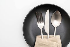 Empty plate spoon fork and knife. Isolated on white background royalty free stock photography