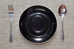Empty plate with spoon and fork. Top view Stock Images