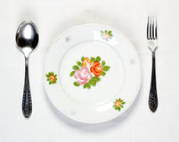 Empty plate with spoon and fork Stock Photography