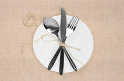 Empty plate with spoon, knife and fork Royalty Free Stock Photography