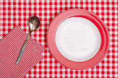 Empty plate with spoon and napkin Stock Image