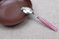 Empty plate with spoon Royalty Free Stock Photo