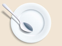 Empty plate with a spoon Royalty Free Stock Photo
