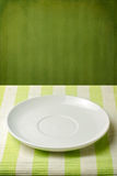 Empty plate on striped tablecloth Royalty Free Stock Photo