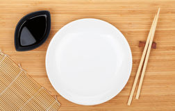 Empty plate, sushi chopsticks and soy sauce Royalty Free Stock Image