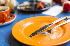 Empty plate on a table after a meal Stock Photos