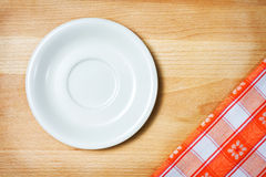 Empty plate on tablecloth Royalty Free Stock Photos