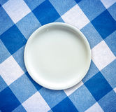 Empty Plate On Tablecloth. Retro Filtered Empty White Plate On A Checked Table Cloth Royalty Free Stock Image