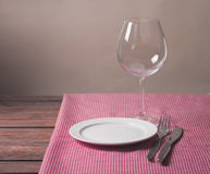 Empty plate. On tablecloth on wooden table Royalty Free Stock Photo