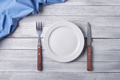 Empty plate. On tablecloth on wooden table Stock Photography