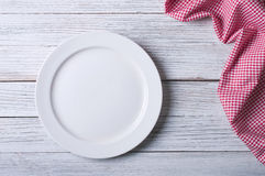 Empty plate. On tablecloth on wooden table Stock Photo