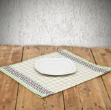 Empty plate on tablecloth Royalty Free Stock Image