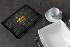 Tableware with online menu on tablet. Empty plate and tableware with online order menun stock image
