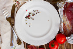 Empty plate with tomatoes and jamon Royalty Free Stock Images
