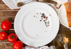 Empty plate with tomatoes and olive oil Royalty Free Stock Photos