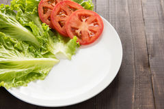 Empty plate with tomatoes and vegetable waiting for food. Stock Image