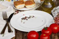 Empty plate with tomatoes Stock Photos