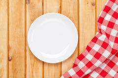 Empty plate and towel over wooden table background Stock Photo