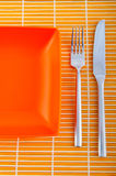 Empty plate with utensils Royalty Free Stock Image