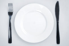 Empty plate and utensils Royalty Free Stock Images
