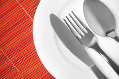 Empty plate and utensils Stock Images