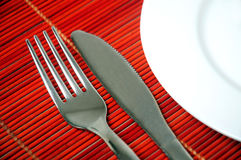 Empty plate and utensils Stock Image