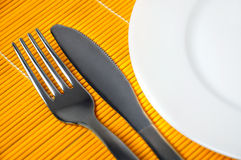 Empty plate and utensils Stock Photo